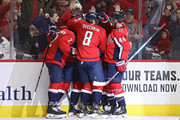 Devante Smith-Pelly #25 of the Washington Capitals celebrates his goal with teammates against the Florida Panthers during the second period at Capital One Arena on October 19, 2018 in Washington, DC.
