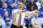 Billy Donovan the head coach of the Florida Gators gives instructions to his team during the game against the Kentucky Wildcats  at Rupp Arena on March 7, 2015 in Lexington, Kentucky.