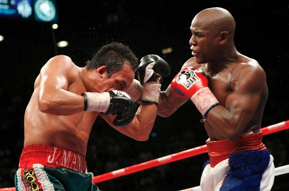 Floyd Mayweather Jr. v Juan Manuel Marquez [combat sport,barechested,boxing,contact sport,professional boxer,sport venue,boxing ring,boxing glove,professional boxing,boxing equipment,floyd mayweather jr.,juan manuel marquez,v,head,right,r-l,mexico,mgm grand garden arena,las vegas,welterweight bout]