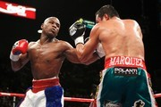 (L-R) Floyd Mayweather Jr. throws a left to the body of Juan Manuel Marquez of Mexico during their welterweight bout at the MGM Grand Garden Arena September 19, 2009 in Las Vegas, Nevada.