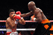 (R-L) Floyd Mayweather Jr. connects with a right to the face of Victor Ortiz during their WBC welterweight title fight at the MGM Grand Garden Arena on September 17, 2011 in Las Vegas, Nevada.