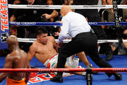 (R) Referee Joe Cortez calls the fight after (C) Victor Ortiz is knocked out by Floyd Mayweather Jr. during their WBC welterweight title fight at the MGM Grand Garden Arena on September 17, 2011 in Las Vegas, Nevada.