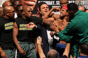 (L-R) Boxer Floyd Mayweather Jr. looks over at Victor Ortiz as Ortiz is held back after the weigh-in for their WBC welterweight title fight at the MGM Grand Garden Arena on September 16, 2011 in Las Vegas, Nevada. Mayweather and Ortiz will meet in a 12-round bout on September 17, 2011 in Las Vegas, Nevada.