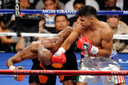 (R-L) Victor Ortiz throws a right at the head of Floyd Mayweather Jr. during their WBC welterweight title fight at the MGM Grand Garden Arena on September 17, 2011 in Las Vegas, Nevada.