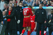 Manager Gerard Houllier (L) of Liverpool looks concerned as Steven Gerrard walks off the pitch after receiving a red card during the FA Barclaycard Premiership match between Chelsea and Liverpool on May 11, 2003 at Stamford Bridge in London.