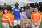 Food Bank For New York City kicks off EATWISE, it's summer nutrition awareness program for teens with NFL superstar and Food Bank ambassador Chris Canty at his Camp Of Champions, seen here with EATWISE teen ambassadors and COO of Food Bank For New York City, Lisa Hines-Johnson .at George Washington High School Field on June 29, 2015 in New York City.