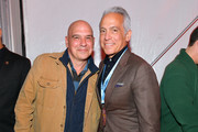 Michael Symon and Geoffrey Zakarian at Titans of BBQ presented by National Beef and Pat LaFrieda Meats hosted by Dario Cecchini, Pat LaFrieda and Michael Symon at Pier 97 on October 12, 2019 in New York City.