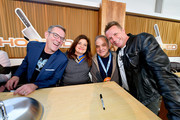 (L-R) Ted Allen, Chef Alex Guarnaschelli, NYCWFF Founder Lee Brian Schrager and Chef Marc Murphy pose during Sunday Brunch hosted by Marc Murphy and Devour Power at Pier 97 on October 13, 2019 in New York City.
