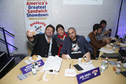 (L-R) TV Personality Adam Richman, Pizza Love founder Kathy Wakile and Goldbelly CEO Joe Ariel attend America's Greatest Sandwich Showdown presented by Goldbelly hosted by Adam Richman and Joe Ariel during the New York City Wine and Food Festival at Highline Stages on October 13, 2019 in New York City.