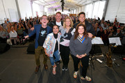 (L-R) Ted Allen, Maneet Chauhan, Marc Murphy, Amanda Freitag, Scott Conant, and Alex Guarnaschelli pose onstage during Sunday Brunch hosted by Marc Murphy and Devour Power at Pier 97 on October 13, 2019 in New York City.