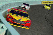 Joey Logano, driver of the #22 Shell-Pennzoil Ford, leads Dale Earnhardt Jr., driver of the #88 National Guard Chevrolet, and Matt Kenseth, driver of the #20 Dollar General Toyota, during the NASCAR Sprint Cup Series Ford EcoBoost 400 at Homestead-Miami Speedway on November 16, 2014 in Homestead, Florida.