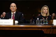 "Former CEO of Equifax Richard Smith (L) and former CEO of Yahoo Marissa Mayer (R) wait for the beginning of a hearing before Senate Commerce, Science and Transportation Committee November 8, 2017 on Capitol Hill in Washington, DC. The committee held a hearing on ""Protecting Consumers in the Era of Major Data Breaches."""