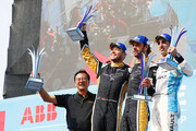 In this handout provided by FIA Formula E - Ivan Yim, Managing Director, Techeetah, Andre Lotterer (BEL), TECHEETAH, Renault ZE 17, Jean-Eric Vergne (FRA), TECHEETAH, Renault ZE 17, and Sébastien Buemi (SUI), Renault eDams, Renault ZE 17, celebrate on the podium during the Santiago ePrix, Round 4 of the 2017/18 FIA Formula E Series on February 3, 2018 in Santiago, Chile.