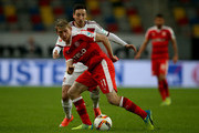Axel Bellinghausen of Duesseldorf is challenged by Kevin Moehwald of Nuernberg during the Second Bundesliga match between Fortuna Duesseldorf and 1. FC Nuernberg at Esprit-Arena on February 22, 2016 in Duesseldorf, Germany.