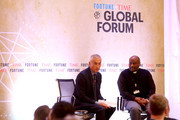 Father Mussie Zera (R)i, Chairman of Habeshia Agency Cooperation for Development, and Jorge Ramos, Senior News Anchor of Univision and Journalist, speak at the Fortune + Time Global Forum 2016 on December 2, 2016 in Rome, Italy.