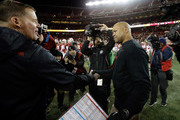 Head coach David Shaw of the Stanford Cardinal shakes hands with head coach Randy Edsall of the Maryland Terrapins after the Cardinal defeated the Terrapins in the Foster Farms Bowl at Levi's Stadium on December 30, 2014 in Santa Clara, California.