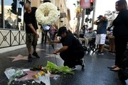 Flowers are placed on the Hollywood Walk of Fame star belonging to Playboy Magazine founder Hugh Hefner, after he died aged 91, in Hollywood, California on September 28, 2017.  / AFP PHOTO / Mark RALSTON