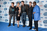 """(L-R) """"American Idol"""" judges musician Keith Urban, actress/singer Jennifer Lopez, musician Harry Connick Jr., host Ryan Seacrest and musician Randy Jackson arrive at Fox's """"American Idol Xlll"""" Finalists Party at Fig and Olive on February 20, 2014 in West Hollywood, California."""