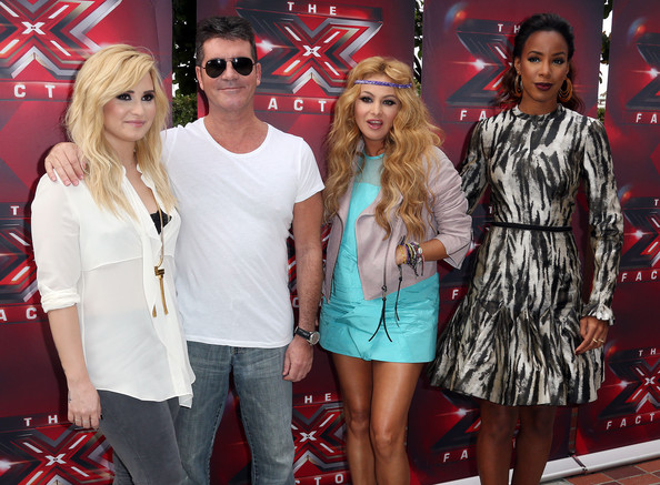 (L-R) Recording artist Demi Lovato, producer Simon Cowell, recording artists Paulina Rubio and Kelly Rowland attend Fox's 'The X Factor' Judges at the Galen Center on July 11, 2013 in Los Angeles, California.
