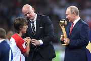 Luka Modric of Croatia receives the adidas Golden Ball award from President of Russia Valdimir Putin during the 2018 FIFA World Cup Final between France and Croatia at Luzhniki Stadium on July 15, 2018 in Moscow, Russia.