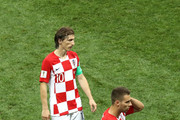 Luka Modric nd Marko Pjaca of Croatia look on dejected during the 2018 FIFA World Cup Final between France and Croatia at Luzhniki Stadium on July 15, 2018 in Moscow, Russia.