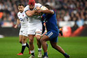 James Haskell of England is tackled by Maxime Machenaud of France and Jefferson Poirot of France during the NatWest Six Nations match between France and England at Stade de France on March 10, 2018 in Paris, France.
