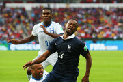 Patrice Evra of France reacts after a challenge by Victor Bernardez of Honduras during the 2014 FIFA World Cup Brazil Group E match between France and Honduras at Estadio Beira-Rio on June 15, 2014 in Porto Alegre, Brazil.