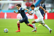 Mathieu Valbuena of France dribles past Andy Najar of Honduras  during the 2014 FIFA World Cup Brazil Group E match between France and Honduras at Estadio Beira-Rio on June 15, 2014 in Porto Alegre, Brazil.