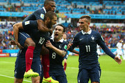 Karim Benzema of France celebrates scoring the first goal with Patrice Evra, Mathieu Valbuena and Antoine Griezmann during the 2014 FIFA World Cup Brazil Group E match between France and Honduras at Estadio Beira-Rio on June 15, 2014 in Porto Alegre, Brazil.
