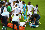 Wilson Palacios of Honduras lies on the field receiving treatment as referee Sandro Ricci tries to restore order during the 2014 FIFA World Cup Brazil Group E match between France and Honduras at Estadio Beira-Rio on June 15, 2014 in Porto Alegre, Brazil.