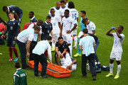 Wilson Palacios of Honduras lies on the field receiving treatment after a play during the 2014 FIFA World Cup Brazil Group E match between France and Honduras at Estadio Beira-Rio on June 15, 2014 in Porto Alegre, Brazil.