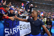 Patrice Evra of France celebrates with the supporters after his team's 5-2 win in the UEFA EURO 2016 quarter final match between France and Iceland at Stade de France on July 3, 2016 in Paris, France.