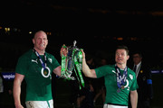 Captain, Paul O'Connell of Ireland and Brian O'Driscoll celebrate with the Six Nations Championship during the RBS Six Nations match between France and Ireland at Stade de France on March 15, 2014 in Paris, France.