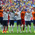 Rio Mavuba Lucas Digne Photos - France acknowledge the fans after defeating Nigeria 2-0 during the 2014 FIFA World Cup Brazil Round of 16 match between France and Nigeria at Estadio Nacional on June 30, 2014 in Brasilia, Brazil. - France v Nigeria