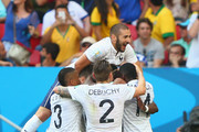 Paul Pogba of France celebrates scoring his team's first goal with teammates during the 2014 FIFA World Cup Brazil Round of 16 match between France and Nigeria at Estadio Nacional on June 30, 2014 in Brasilia, Brazil.