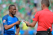Patrice Evra of France argues with a referee during the UEFA Euro 2016 round of 16 match between France and the Republic of Ireland at Stade des Lumieres on June 26, 2016 in Lyon, France.