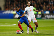 Patrice Evra of France gets past the tackle from Roman Shirokov of Russia during the International Friendly match between France and Russia held at Stade de France on March 29, 2016 in Paris, France.