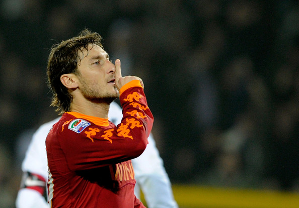Francesco Totti Francesco Totti of AS Roma (C) celebrates after scoring the 1-1 equaliser from a penalty during the Serie A match between Juventus and Roma at Olimpico Stadium on November 13, 2010 in Turin, Italy.