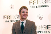 """Seth Gabel waits for a interview while on the red carpet while attending """"Fringe"""" celebrates 100 episodes and final season at Fairmont Pacific Rim on December 1, 2012 in Vancouver, Canada."""