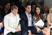 (L-R) Kleinfeld Bridal Fashion Director Terry Hall, television personalities Josh Murray and Andi Dorfman sit front row at The Mark Zunino For Kleinfeld 2015 Runway Show at Kleinfeld on October 14, 2014 in New York City.