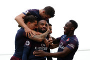 Alexandre Lacazette of Arsenal celebrates with teammates after scoring his team's second goal during the Premier League match between Fulham FC and Arsenal FC at Craven Cottage on October 7, 2018 in London, United Kingdom.