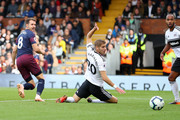 Aaron Ramsey of Arsenal scores his team's third goal during the Premier League match between Fulham FC and Arsenal FC at Craven Cottage on October 7, 2018 in London, United Kingdom.