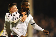 Moussa Dembele (R) of Fulham celebrates his winning goal with Jordan Evans (L) during the FA Youth Cup Semi Final second leg match at Craven Cottage on April 7, 2014 in London, England.