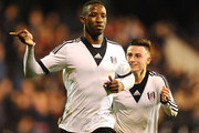 Moussa Dembele (L) of Fulham celebrates his winning goal with Jordan Evans (R) during the FA Youth Cup Semi Final second leg match at Craven Cottage on April 7, 2014 in London, England.