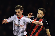 Scott Parker of Fulham holds off Marc Pugh of Bournemouth during the Sky Bet Championship match between Fulham and AFC Bournemouth at Craven Cottage on March 6, 2015 in London, England.