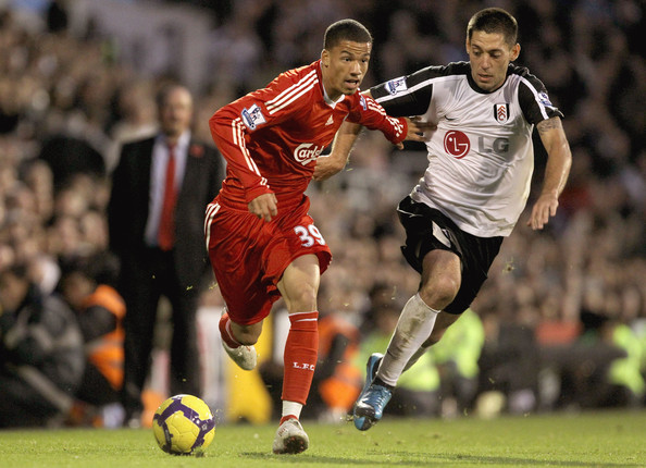 Nathan Eccleston of Liverpool is challenged by Clint Dempsey of Fulham during the Barclays Premier League match between Fulham and Liverpool at Craven Cottage on October 31, 2009 in London, England.