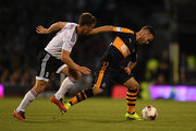 Daryl Janmaat of Newcastle holds off pressure from Scott Parker of Fulham during the Sky Bet Championship match between Fulham and Newcastle United at Craven Cottage on August 5, 2016 in London, England.