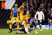 Scott Parker (R) of Fulham challenges Eoin Doyle (L) of Preston North End during the Sky Bet Championship match between Fulham and Preston North End at Craven Cottage on November 28, 2015 in London, England.