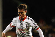 Scott Parker of Fulham runs with the ball during the Sky Bet Championship match between Fulham and Reading at Craven Cottage on January 17, 2015 in London, England.