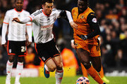 (L-R) Scott Parker of Fulham challenges Bakary Sako of Wolverhampton Wanderers during the FA Cup Third Round match between Fulham and Wolverhampton Wanderers at Craven Cottage on January 3, 2015 in London, England.